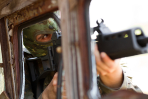 © Hurricanehank | Dreamstime.com - Terrorist In Mask With A Gun Photo